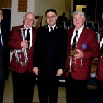 Former members Ian Watkinson, Stan Abraham and Deryck Diffey pictured with Peter Moore and Bandmaster Andrew Blyth.