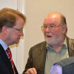 Peter Wise in deep conversation with Maurice Patterson