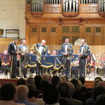 The RAF Brass Quintet arriving on stage to perform Variations on America by Charles Ives.