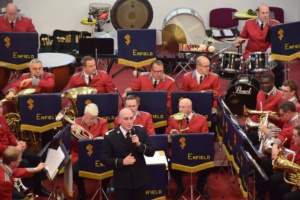Bandmaster Jonathan Corry speaking to the audience, even if the band are not paying too much attention.